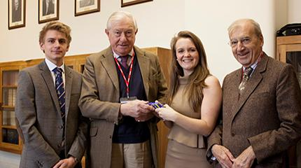 Scholars give thanks to retiring director of CLA Charitable Trust