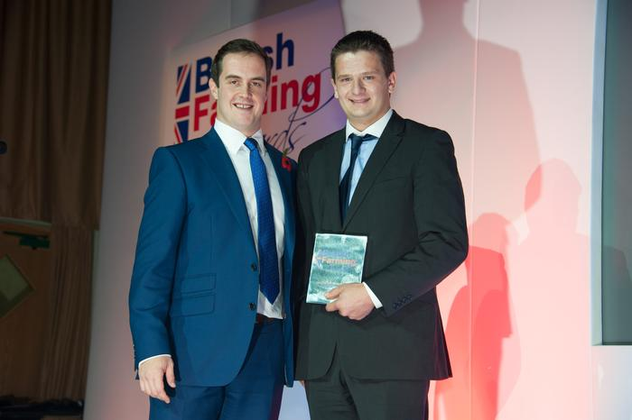 Ross (R) receives his award from Farmers Guardian Business Editor, Ben Briggs