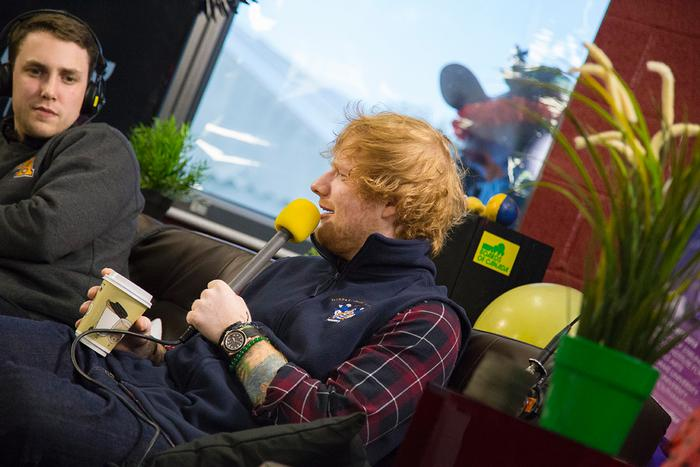 Ed Sheeran sporting a Harper Adams University gilet during the Scott Mills Student Tour Show