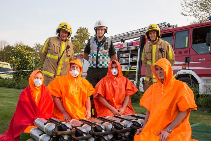Students Erin Madden, Reece Smith, Thomas Baines-Sizeland and Will Aston with emergency crew members