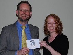 James Armstrong receives his prize from Communications Manager Jaclyn Green