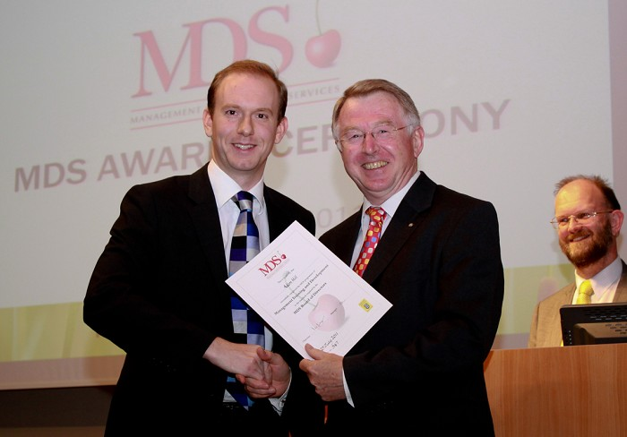 Adam Hill receives his MDS Award from Doug Henderson