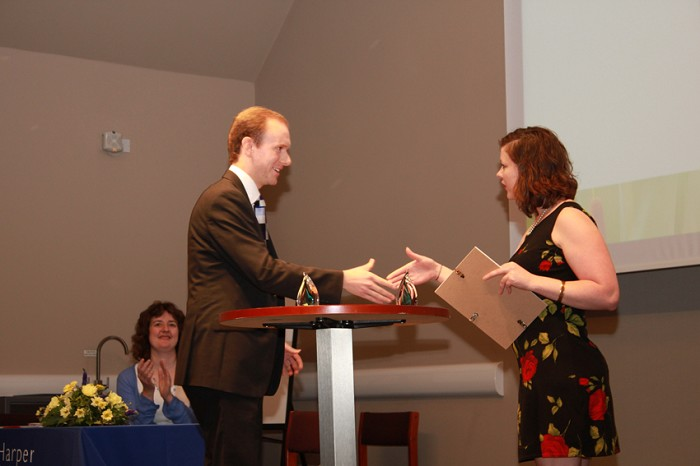 Adam Hill receives his FPJ Award from Liz O'Keefe
