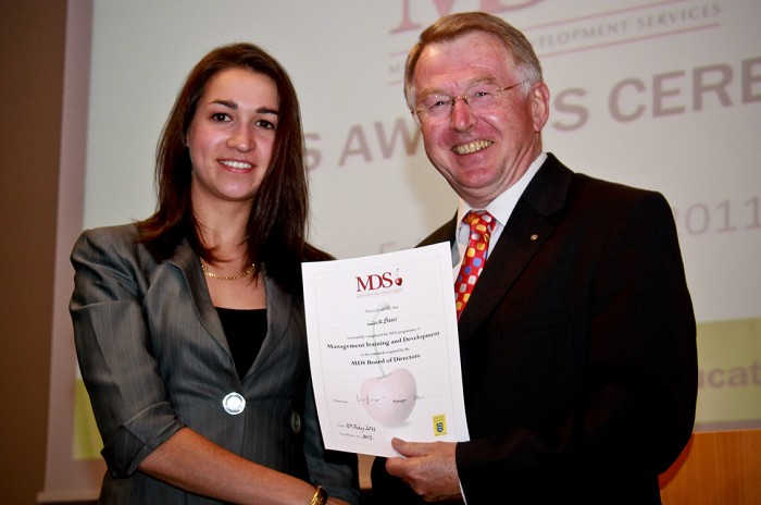 Laura Baver receives her MDS Award from Doug Henderson