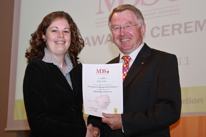 Sally Dutton receives her MDS Award from Doug Henderson