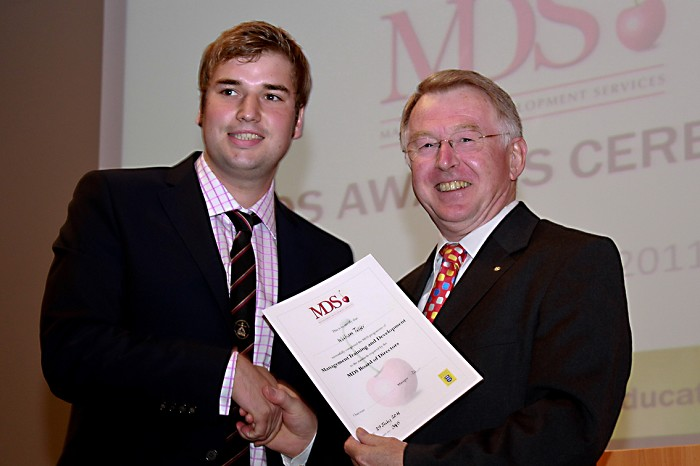William Telfer receives his MDS Award from Doug Henderson