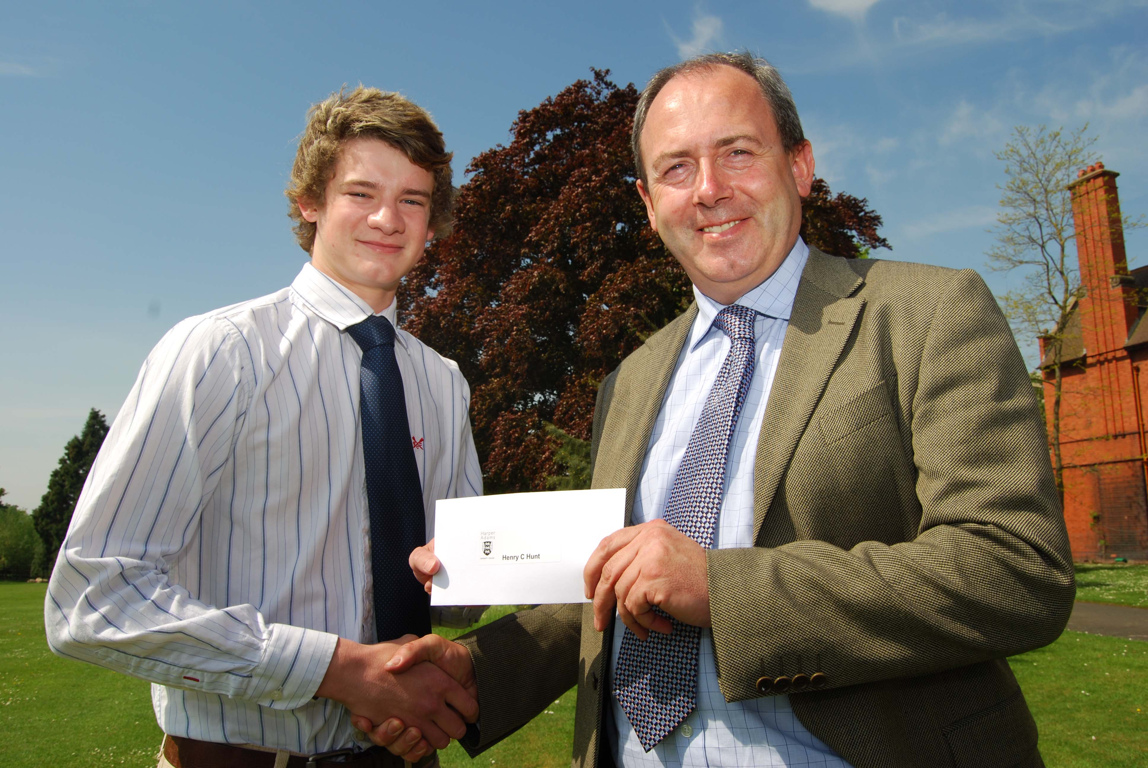 Henry Hunt receives his prize from Tony Asson