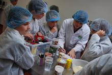 The pupils get to grips with making burgers