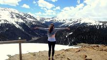 Stephanie on a Colorado mountain pass during her travels across the USA