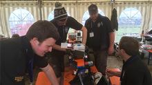 The team working on robot Eric in the pits