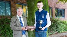Simon Keeble senior lecturer presenting the prizes to Harry Storey