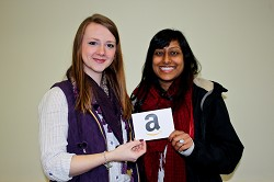 Winner Priya Motupalli receives her prize from Janine Heath, from the Harper Adams communications team