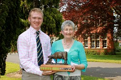 Harry receives his trophy from Mrs Sheila Lewis