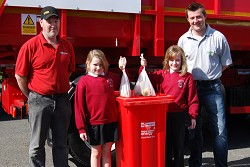 John Cartwright, Director of Cartwright Waste Management, and Harper Adams AD plant manager James Wood launched the scheme at Shifnal Primary School with the help of pupils Chloe Foulkes, left, and Josie Rosser.