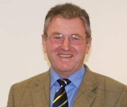 Chairman of the Board of Governors Roger Mercer