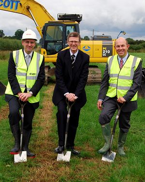 Don Leiper, Dr David Llewellyn and John Ibbett make the first cut into the ground.