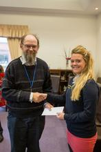Tom Underhill receiving his Aspire Award from SU President Emily Hayman