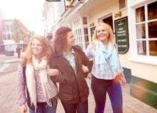 Students walking up Newport highstreet