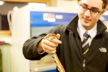 Darren holding a snake in the Companion Animal Unit