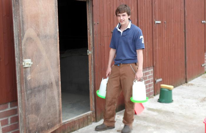 Jacob at work on his dad's chicken farm