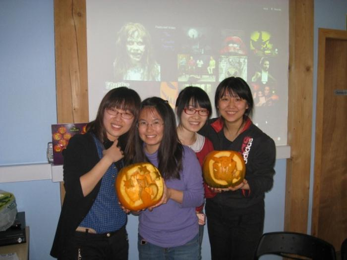 Students Nan Wang, Yinping Wang, Bo Sun, Shuanghui Du with their carved pumpkins