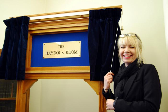 Biddy Haydock reveals the new plaque.