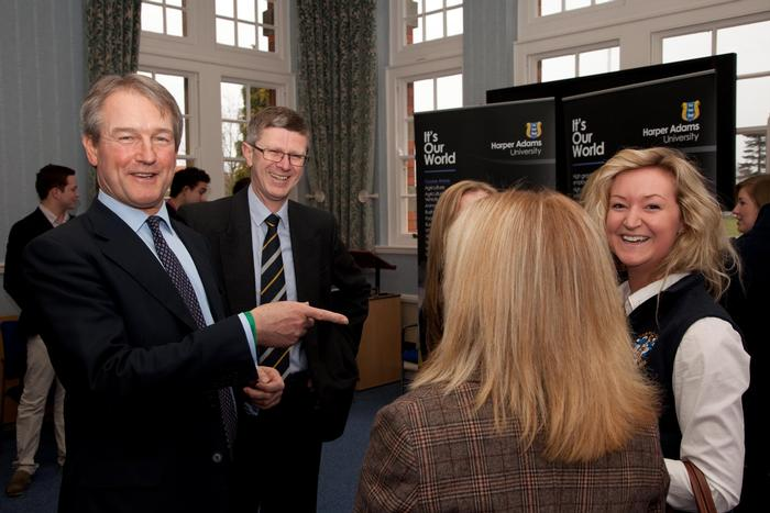 Owen Paterson shares a joke with some of the students
