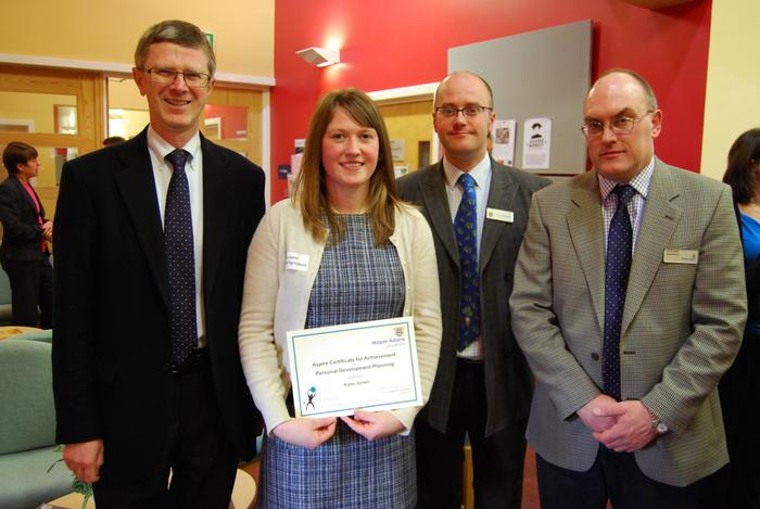 Katie James with Vice-Chancellor Dr David Llewellyn, left, Terry Pickthall, second from the right, and Dr Russell Readman
