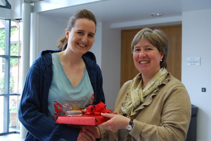 Lauren receives her gift from Dr Baxter