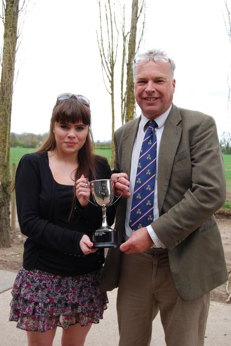 Abby receives the REALM Cup from Simon Keeble