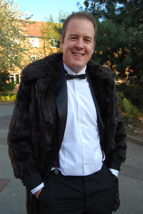 Lecturer Andrew Black embraces the 'fur and feathers' theme with a faux coat.