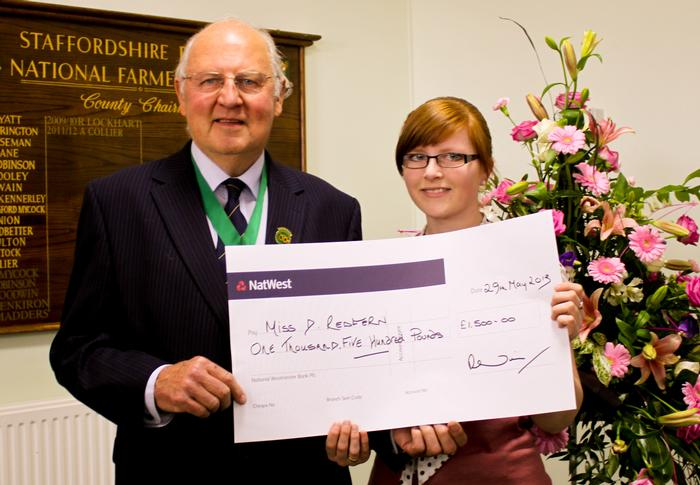 Devinia Redfern is presented with her scholarship by Society President John Edwards