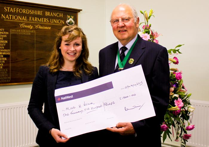 Harriet Wilson is presented with her scholarship from Society President John Edwards