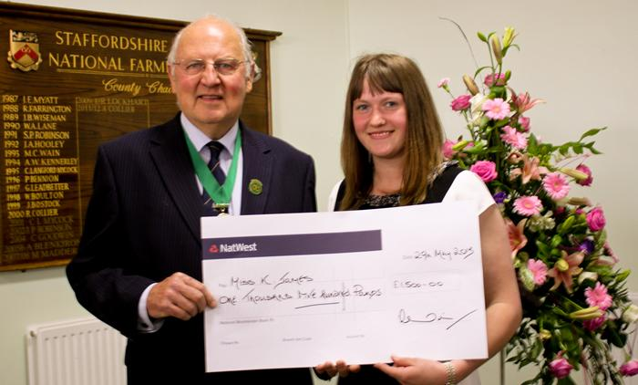 Katie James is presented with her schaolsrhip by Society President John Edwards