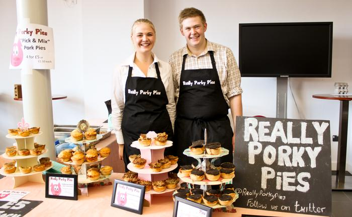 Students Michelle Evans and Jake Cooper man the Really Porky Pies stand