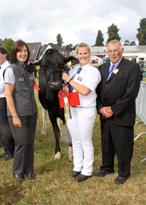 Lorraine Westwood presents winning young handler Nadine Pilkington with her prize