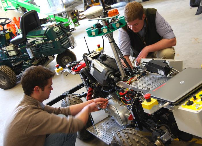 Students working on an autonomous vineyard robot