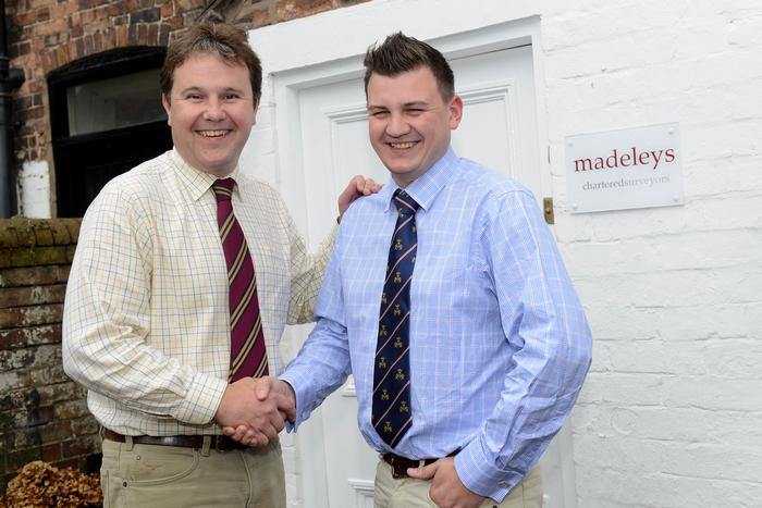 Paul Madeley (left) welcomes Chris Powell to Madeleys Chartered Surveyors