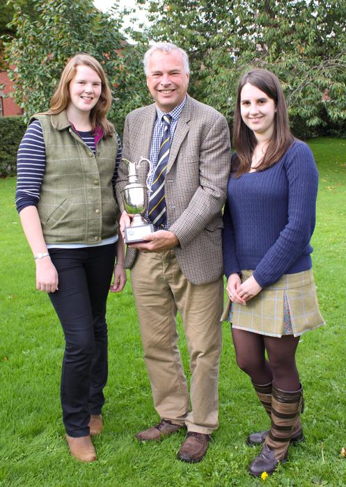REALM course leader Simon Keeble presents the cup to students Sally Abel (left) and Gillian Wilsher (right)