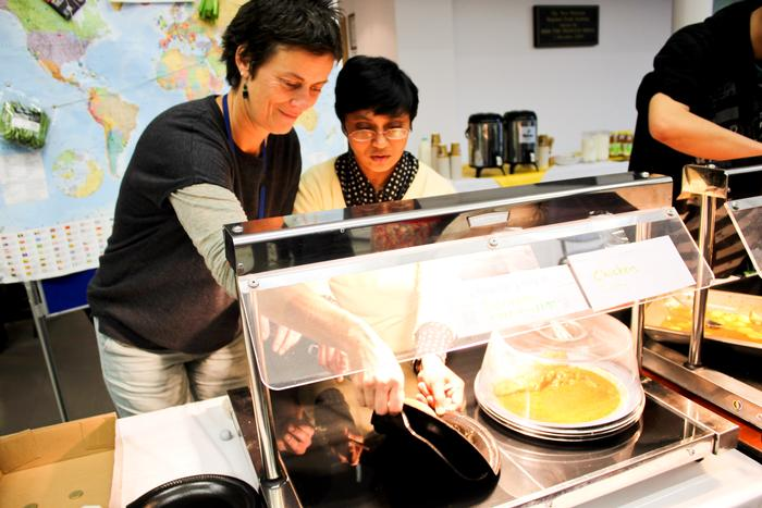 Jo Rawlinson helps some of the international students who provided food. on the day