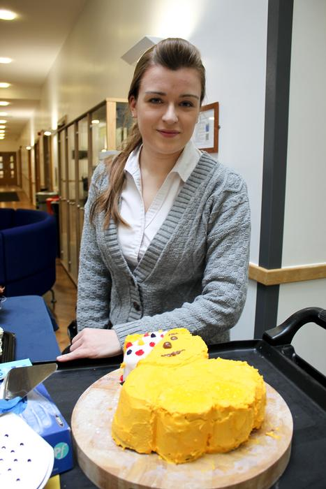 Emma Fern, catering placement student, with the Pudsey cake she decorated.