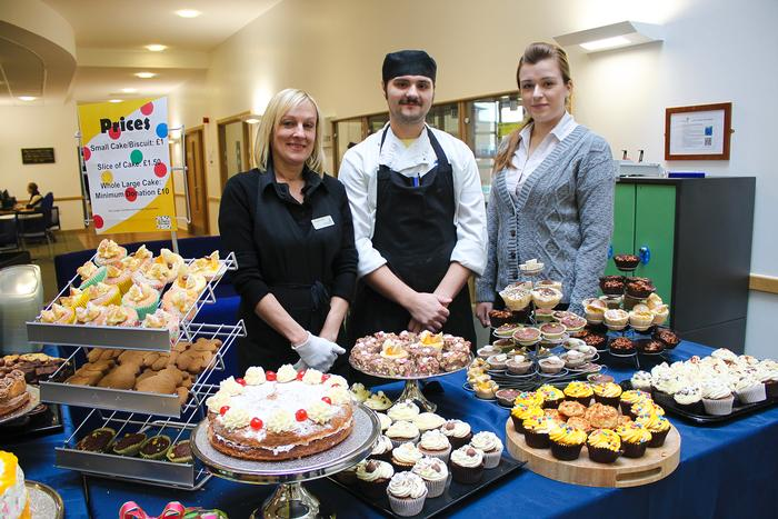 Selling cakes for Children in Need are (left to right) Carolyn Turton, catering assistant, James Chapman, sous chef, and Emma Fern, catering placement student.