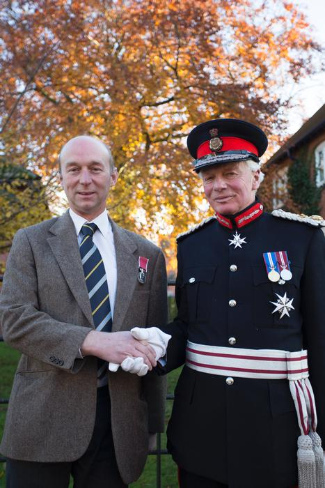 Mark Hall receives the BEM from Lord Lieutenant of Shropshire, Algernon Heber-Percy