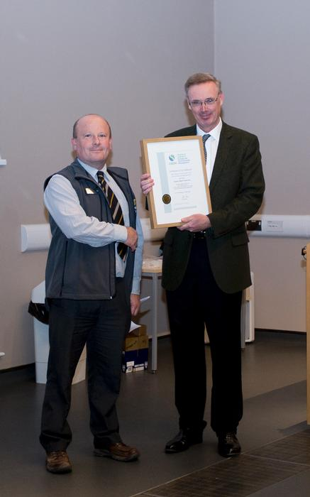Simon Irvin receives the accreditation certificate from David Parker.