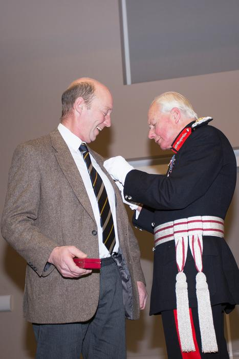 The Lord Lieutenant pins on Mark's medal