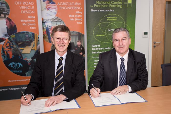 Dr David Llewellyn and Gerard Lavery sign the agreement at Harper Adams University