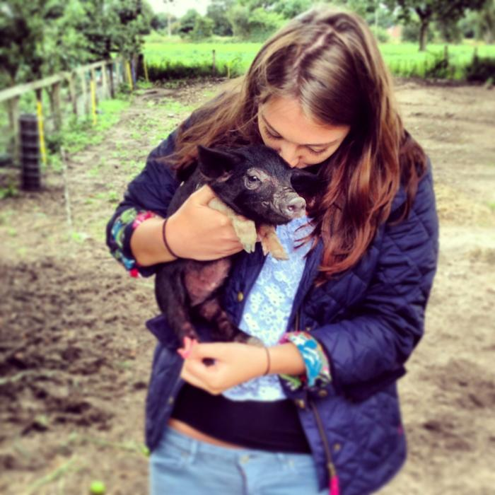 Rebecca with a piglet