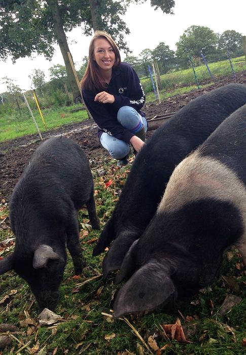 Rebecca with her pigs