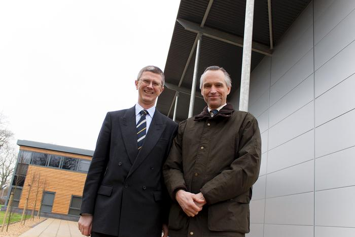 Harper Adams Vice Chancellor and Lord de Mauley outside the new Agricultural Engineering Innovation Centre