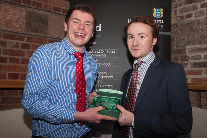Fergus Corrigan receives the Gaelic Football Player of the Year award from Niall Montgomery.